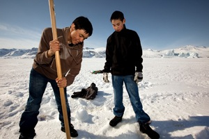 Youngsters at a fishing hole in Greenland. Photo: Lawrence Hislop, UNEP-GRID Arendal