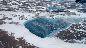 Melting pond on Greenland ice. Photo: Jim Yungel/NASA